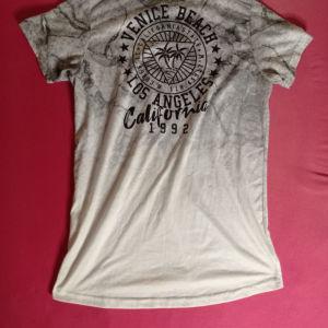 Κομτομάνικη μπλούζα
