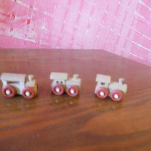 kinder wooden trains