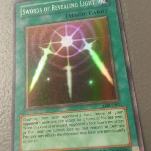 Swords Of Revealing Light (Super Rare, LOB)