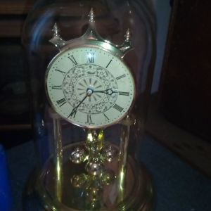 Old golden clock with glas case. Unused.