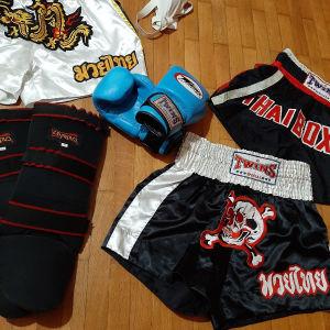 Γάντια- 3 Σορτς - επικαλαμίδες - Spansuar. *Twins αγωνιστικά  γάντια No10        *Επικαλαμίδες Olympus XL                             3 twin shorts =  *Χρυσό  XL         *Νεκροκεφαλή L  *Thai boxing L