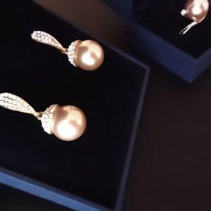 Σετ σκουλαρίκια και δαχτυλίδι με πέρλα