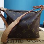 Τσαντάκι χειρός Louis Vuitton