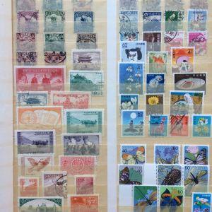 Συλλογη διαφορετικων γραμματοσημων χωρων Ασιας
