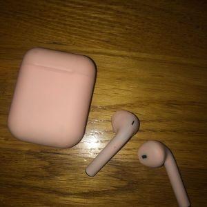 Ασύρματα ρόζ ακουστικά