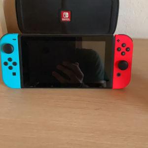Nintendo switch με θήκη εικονιζόμενα παιχνίδια χειριστήριο λογαριασμο eshop και θήκη μεταφορας