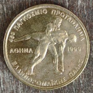 100 Δραχμές / Έτος 1999  / 45ο Παγκόσμιο Πρωτάθλημα Ελληνο-Ρωμαϊκής πάλης