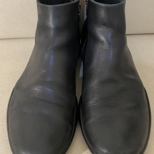 extremely gorgeous extravagant elegant unique genuinely leather black boots by Prada made in Italy size 9 in excellent condition
