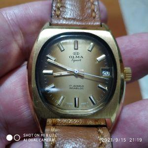 κουρδιστό ρολόι OLMA