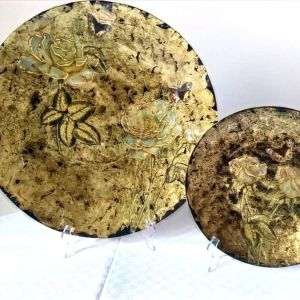 Small and large floral plates with gold decorations and black background