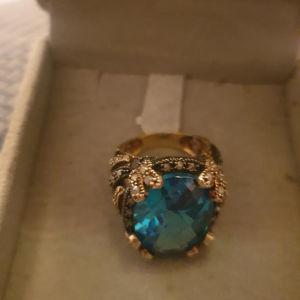 Δαχτυλίδι χρυσό 9Κ διακοσμημένο με ασημί 925 με αληθινά διαμαντάκια και ημιπολύτιμη  πέτρα 14,5 gr