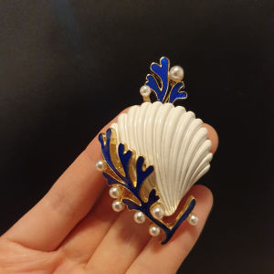 shell brooch