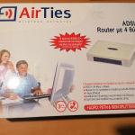 Modem router λευκό Airties στο κουτί του