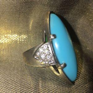 Δακτυλίδι ασημένιο,με τυρκουαζ πέτρα.