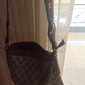 Τσάντα με δερμάτινες λεπτομερειες από outlet sto milano!!