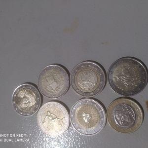 Τα ελληνικά 2 ευρα τις φωτό και ένα ευρώ με το s στο κάτω αστέρι