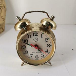 μπρούτζινο ρολόι εποχής λειτουργικό