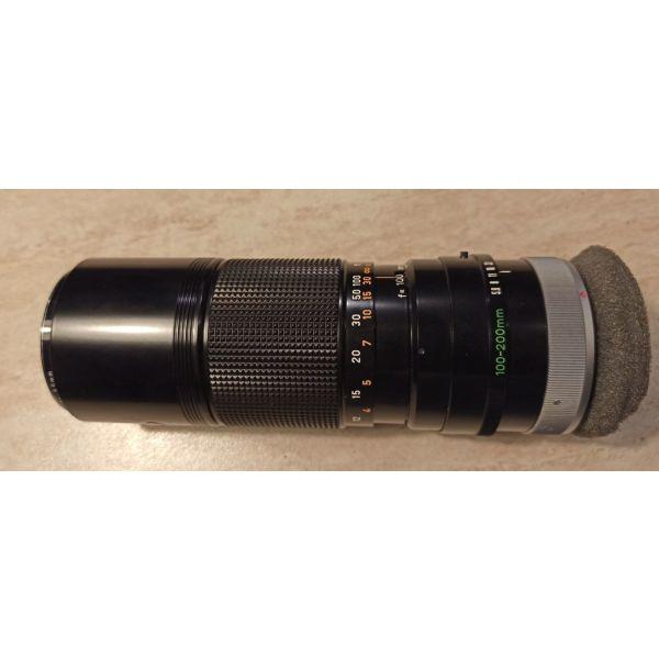 Canon zoom lens FD 100-200mm & thiki metaforas