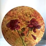 Large and Small floral plates with gold decoration and burgundy red background