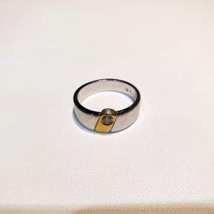 Κίτρινο και λευκόχρυσο δαχτυλίδι 18Κ με διαμάντι brilliant 0.15ct vs, 8γρ.